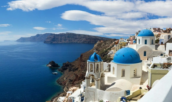 Oia in Santorini and its blue-domed churches and Mediterranean sea views