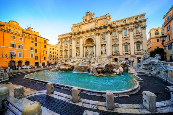 A beautiful sun-lit view of the famous Trevi Fountain in Rome