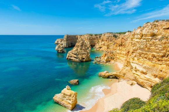 The stunning rocky coastline of Praia da Marinha in Portugal's Algarve