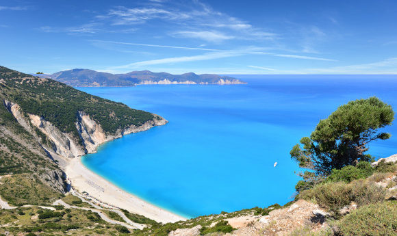 A view from the hillside at the famous Myrtos Beach on the island of Kefalonia in Greece