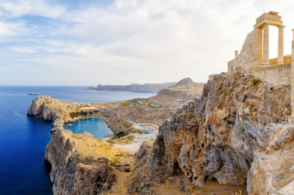 Rhodes Acropolis of Lindos. Doric columns the ancient Temple Athena Lindia the IV century BC and the bay St. Paul