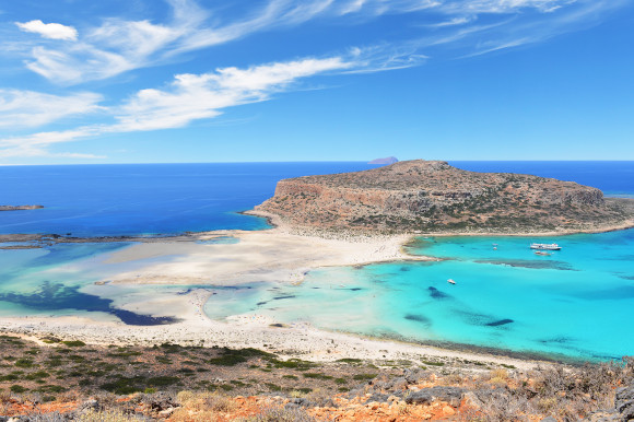 A view of the beautiful Balos Lagoon in Crete taken from the viewpoint at the top of the beach with white sands surrounded by turquoise blue waters