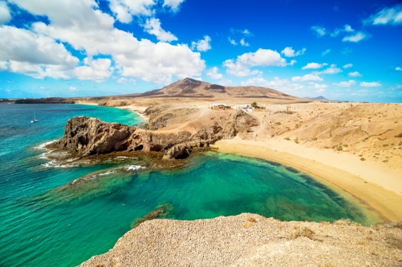 An incredible beach in Lanzarote with azure waters and golden sands
