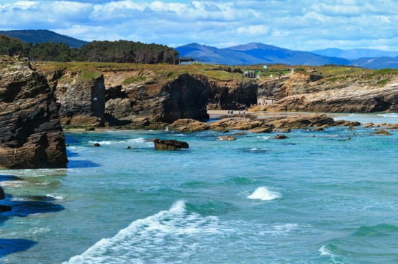 The rocky terrain of the Praia de Augas Galicia Beach in Spain, also known as Beach of Cathedrals.
