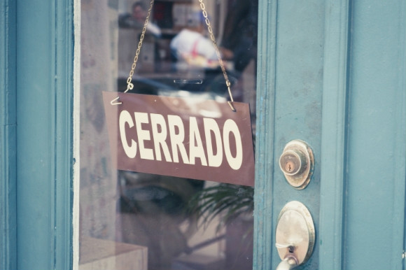 Traditional Siesta time in Spain when the shops are shut. Cerrado is the Spanish word for closed in a shop window.