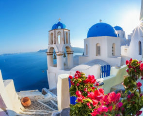 Whitewashed village in Santorini and close up of blue-domed houses in Santorini