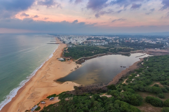 Elevated view of the arresting beach in the town of Quarteira, which is found in Portugal's Algarve