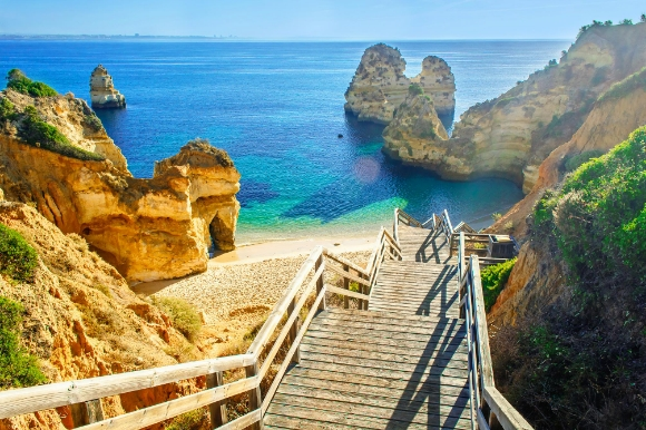 The footbridge down to Lagos rocky beach Praia do Camilo in Portugal's Algarve
