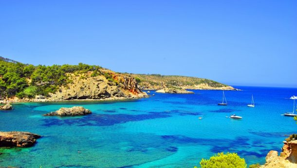 Cala Xarraca Ibiza Beach and its stunning sapphire waters.