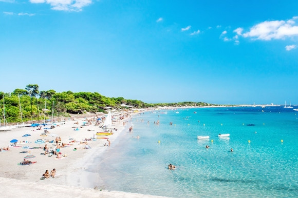 The white shores of Las Salinas Beach and turquoise-tinted waters of Ibiza.