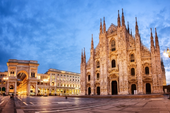The stunning Milan Cathedral in Italy lit up at dusk