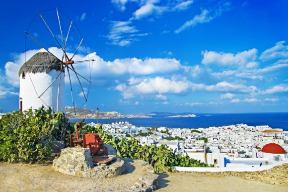 Whitewashed houses and towering windmills of Mykonos in Greece.