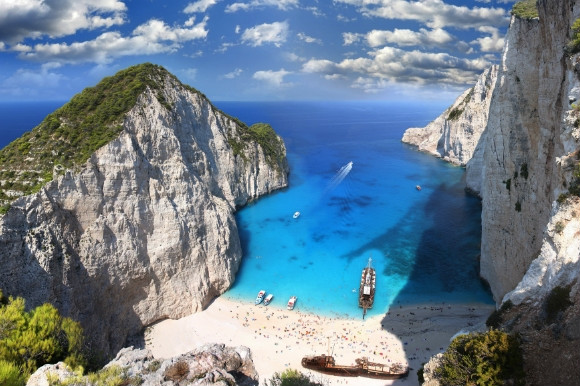 Also known as 'Shipwreck Beach' for its shipwreck in the middle of its white sand and clear blue waters. Navagio Beach is in Zakynthos Greece.