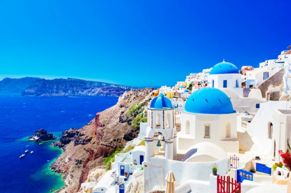 The blue-domed whitewashed village of Oia in Santorini,Greece.