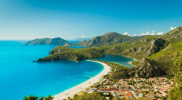 The breathtaking sapphire waters and golden stretch Blue Lagoon in Oludeniz Turkey