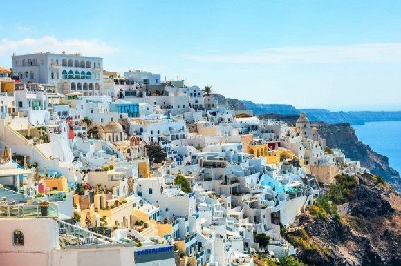 Jaw dropping panorama of the whitewashed resort of Fira in Santorini, Greece.