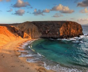 The lunar landscape of Papagayo Beach in Lanzarote and its sapphire waters.