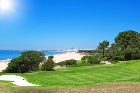 Sunny golf course in Portugal overlooking the Atlantic Ocean