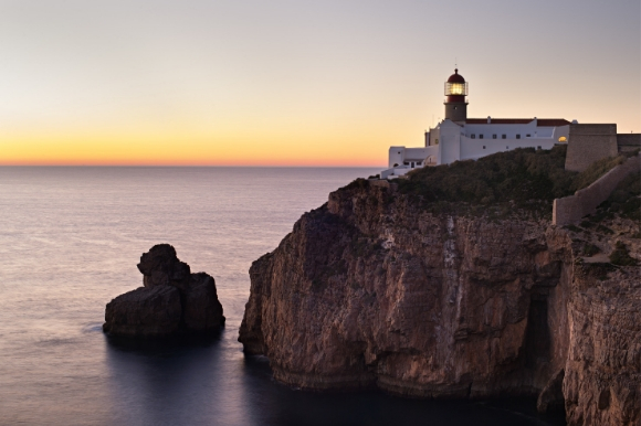 A beautiful sunset over the The famous lighthouse of Cabo Sao Vicente in Sagres, Portugal
