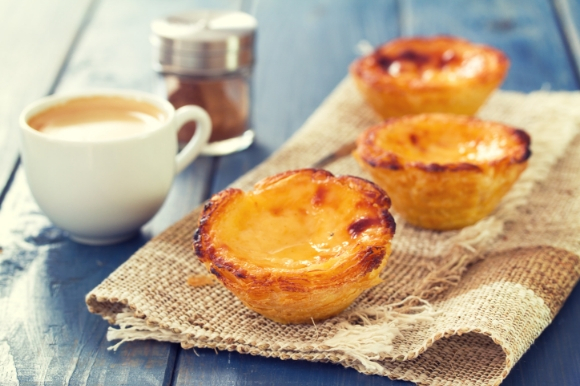 The tasty Portuguese dessert pastel de nata served with a cup of coffee