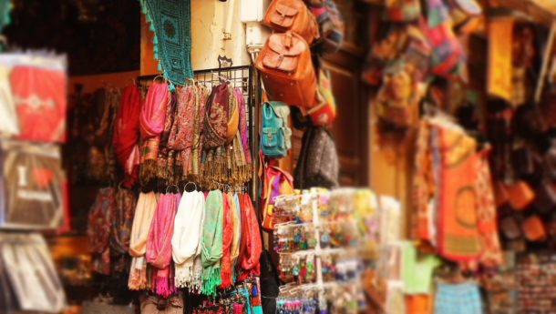 Authentic market stalls and Spanish shops filled with colourful fabrics.