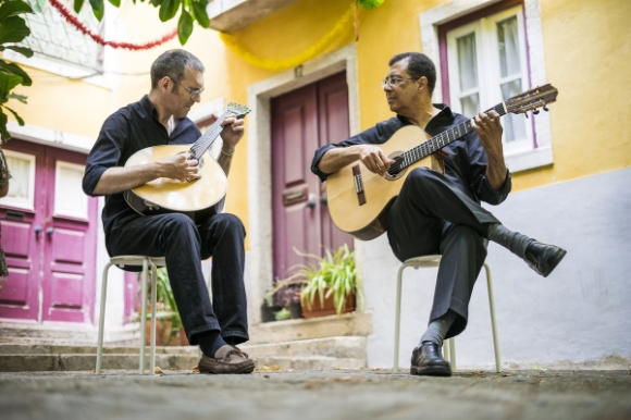 Two Fado guitarists on the streets of Portugal entertaining tourists and locals