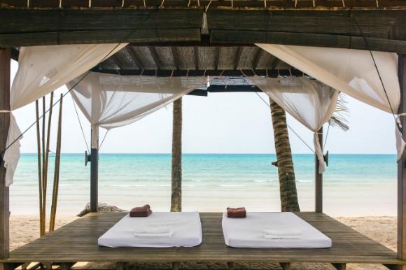 Beach massage wooden hut with two massage beds.