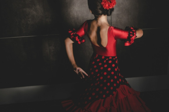 The most traditional dance in Spain, a woman dancing to the Flamenco.