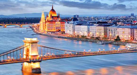 Budapest at night with chain bridge and parliament building overlooking the river side