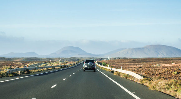 Stunning mountain views from the roads in Spain. Featuring a car driving taking in the epic landscape.