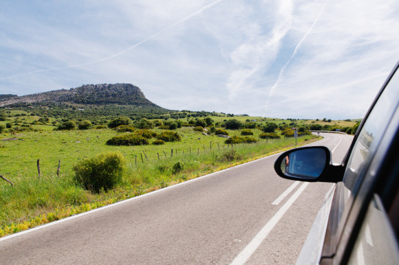 Car driving down a road in Spain taking in the surrounding greenery