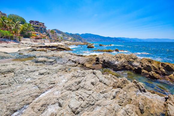 The pebbly shores of Conchas Chinas Beach (Chinese Shell Beach) in Puerto Vallarta Mexico