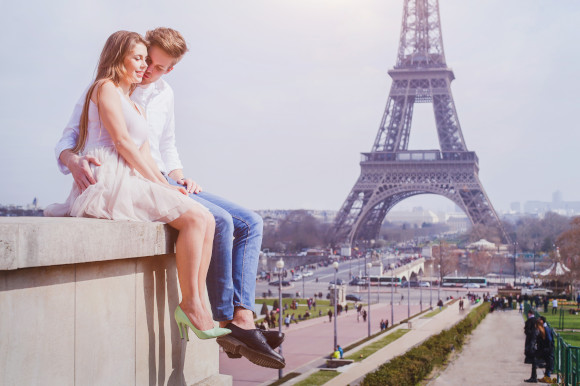 Affectionate young couple in Paris with the Eiffel Tower in the background