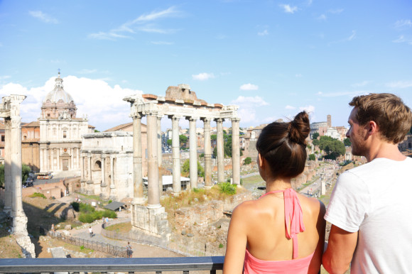 Young couple admiring Rome's ancient attractions from an elevated viewing platform