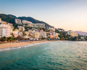 The beautiful resort of Puerto Vallarta in Mexico as the sunsets along the coastline and hotel strip