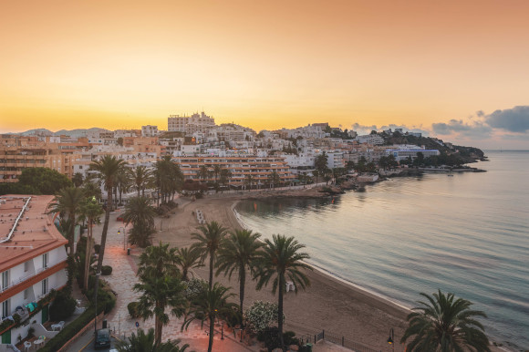 A stunning sunset view of the beach in Figueretas on the island of Ibiza