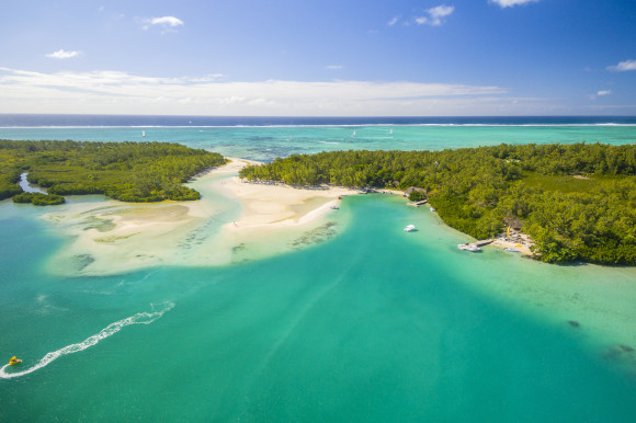 Aerial view of Ile aux Cerfs Beach in Mauritius surrounded by emerald waters and greenery