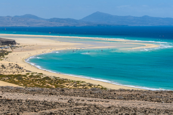 Sotavento Beach in Fuerteventura with golden sweeping sands and azure waters