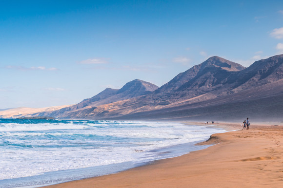 Cofete Beach surrounded by the Jandia Mountains with golden quiet sands