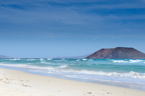 The stunning white sands and turquoise waters of Corralejo Beach in Fuerteventura