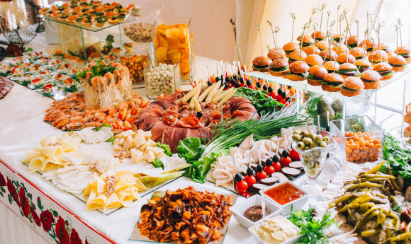 Buffet spread filled with hot and cold options from burgers to meats and salad