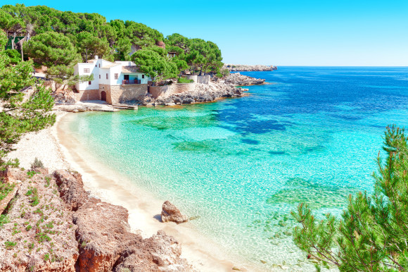 The Idyllic Cala Gat Beach with stunning scenery and shallow, azure waters on the island of Majorca, Spain