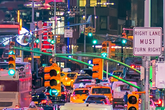 Vibrant Times Square in New York city and its neon lights and traffic-filled roads