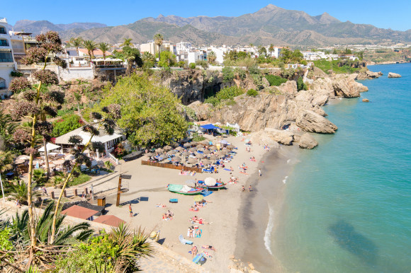 The striking Nerja Beach with a backing off hotels in Spain's beautiful Costa Del Sol region