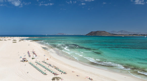 Corralejo Beach on the Canary Island Fuerteventura with a wide body of white sand and clear turquoise waters
