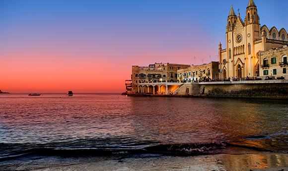 Beautiful sunset view of Spinola Bay, St. Julians and Sliema