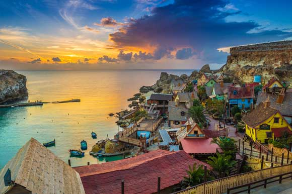 Popeye Village at sunset set in Mellieha overlooking the sea