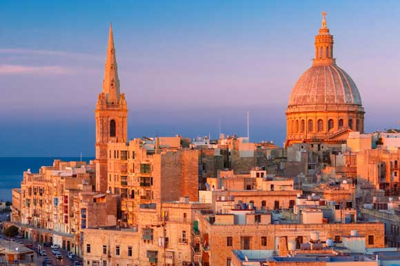 An aerial shot of Malta's capital, Valletta, at sunset