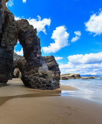 Archways on the beach of Praia de Augas Santas