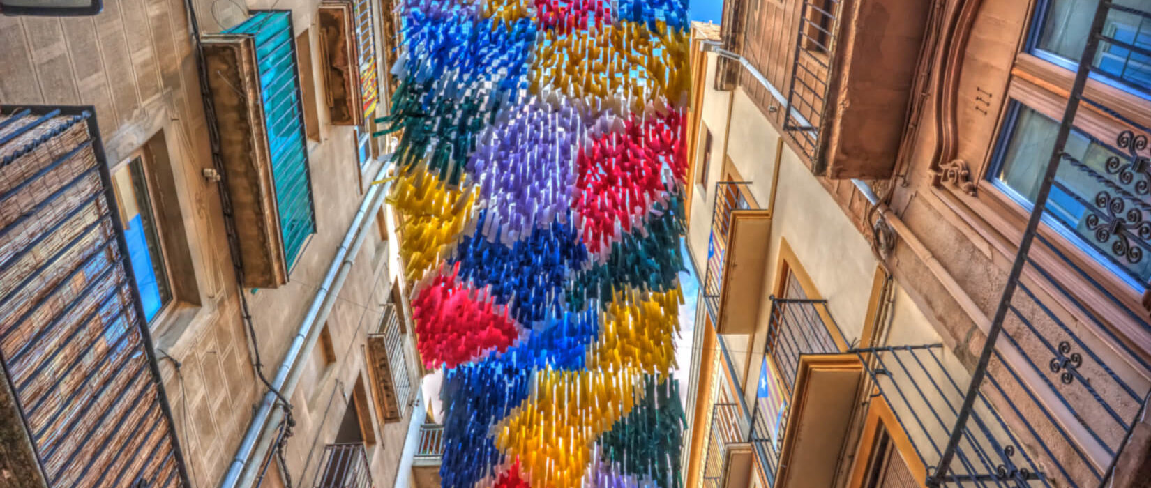 Colourful ribbons aloft during a festival in Spain